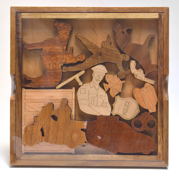 Police Wood Puzzle by David Janelle - © Blue Pomegranate Gallery