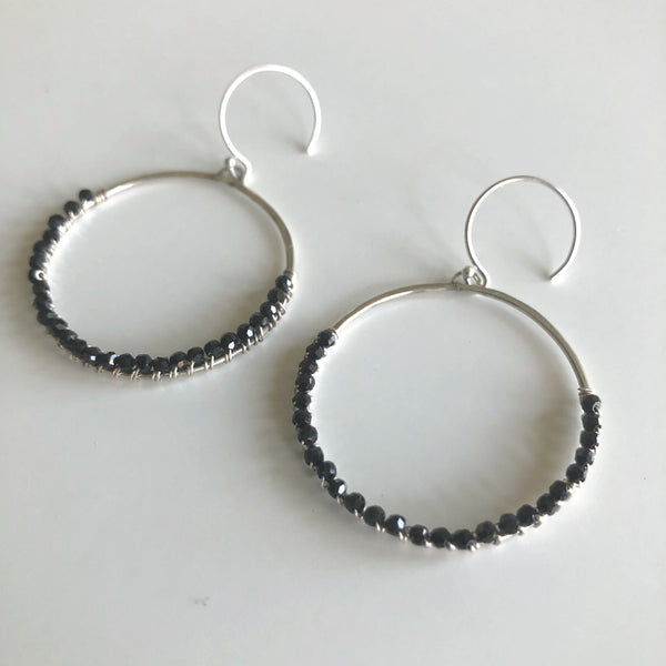 Circle w/ Black Faceted Spinel earrings by Cassie Leaders - © Blue Pomegranate Gallery
