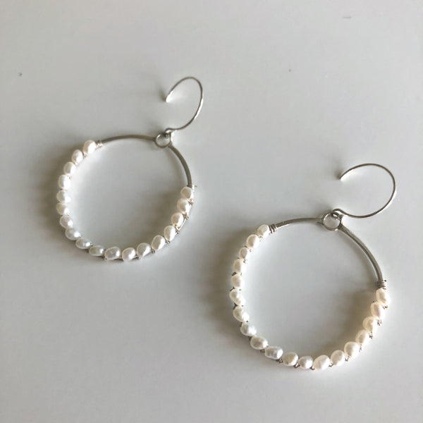 Circle w/ white pearls earrings by Cassie Leaders - © Blue Pomegranate Gallery