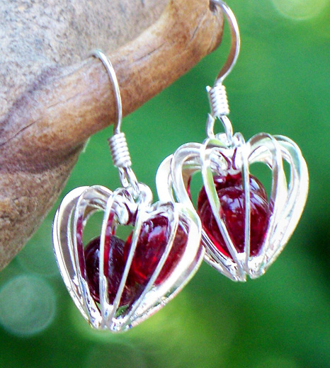 Ruby Heart Cage Earrings by Laura Bergman - © Blue Pomegranate Gallery