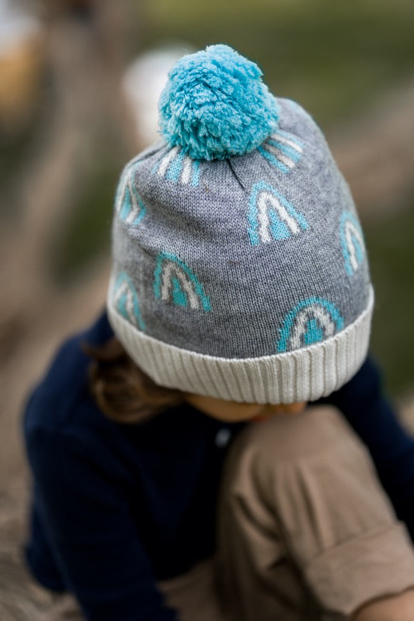 Close up of child wearing ACORN KIDS Rainbow Beanie - Grey & Blue