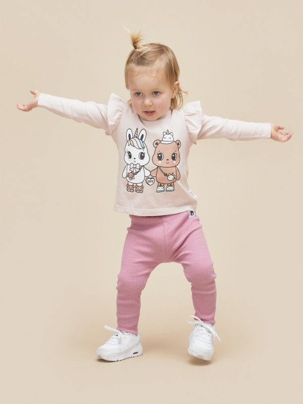 Toddler wearing HUXBABY Furry Friends Frill Top