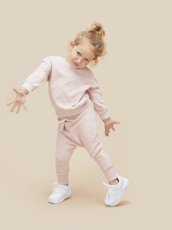 Child wearing HUXBABY Rose Terry Play Pant