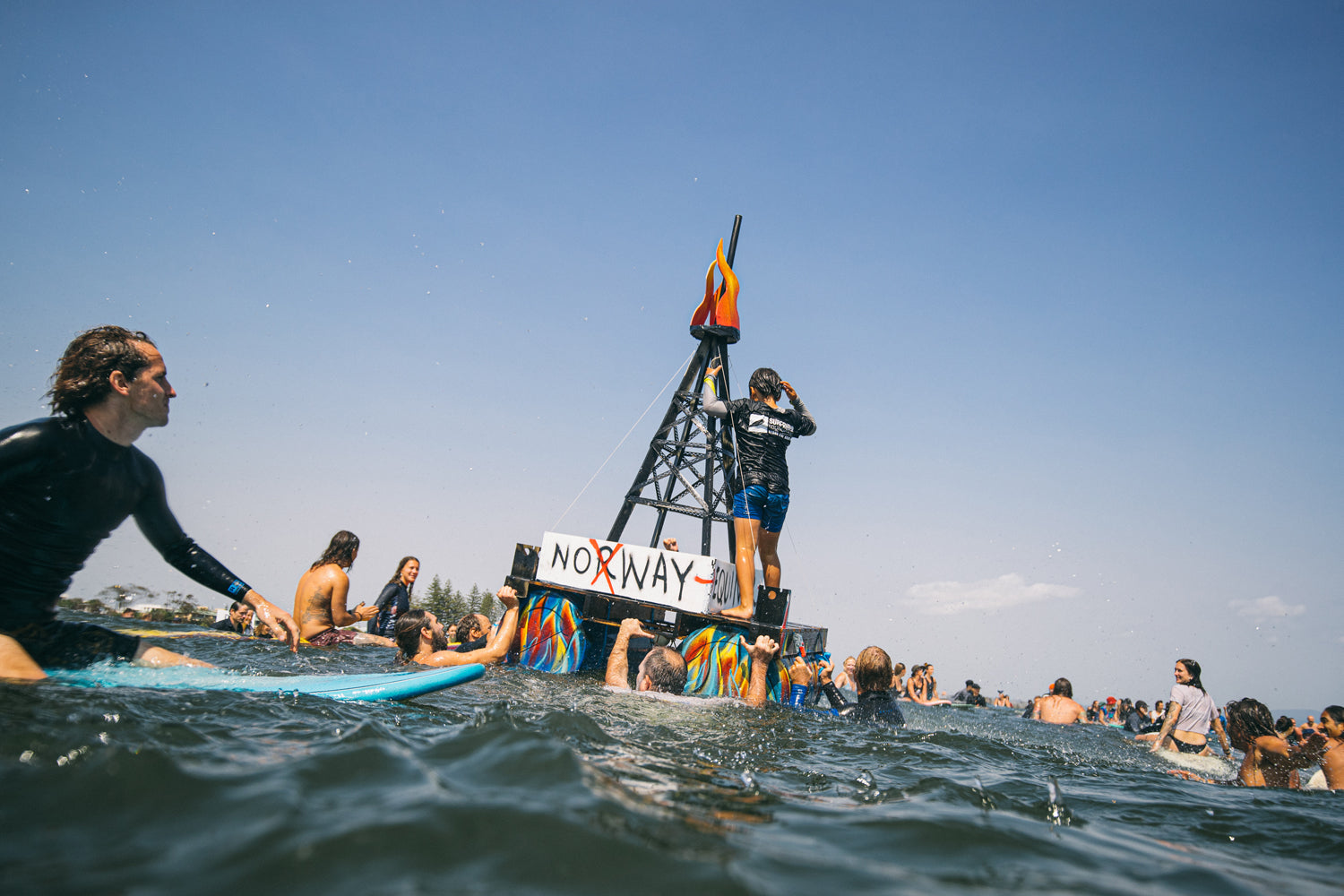 Byron Bay surfers rally around a replica oil rig.