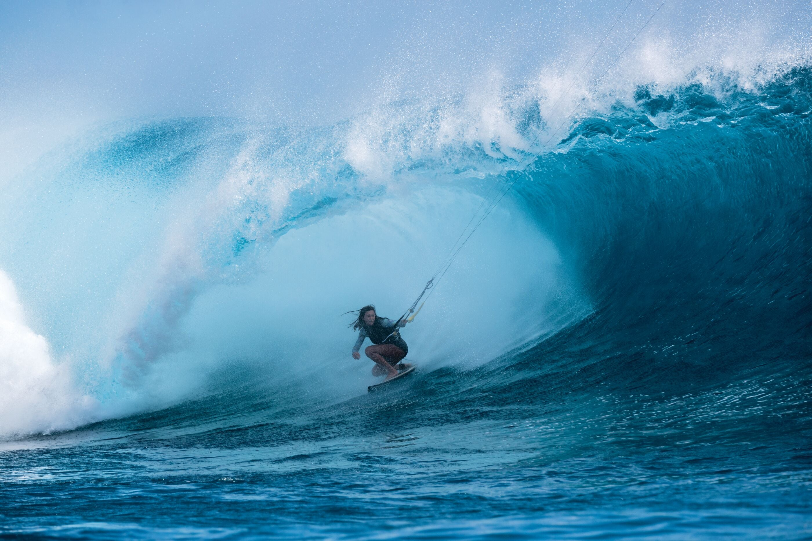 Moona Whyte pulls into a barrel.