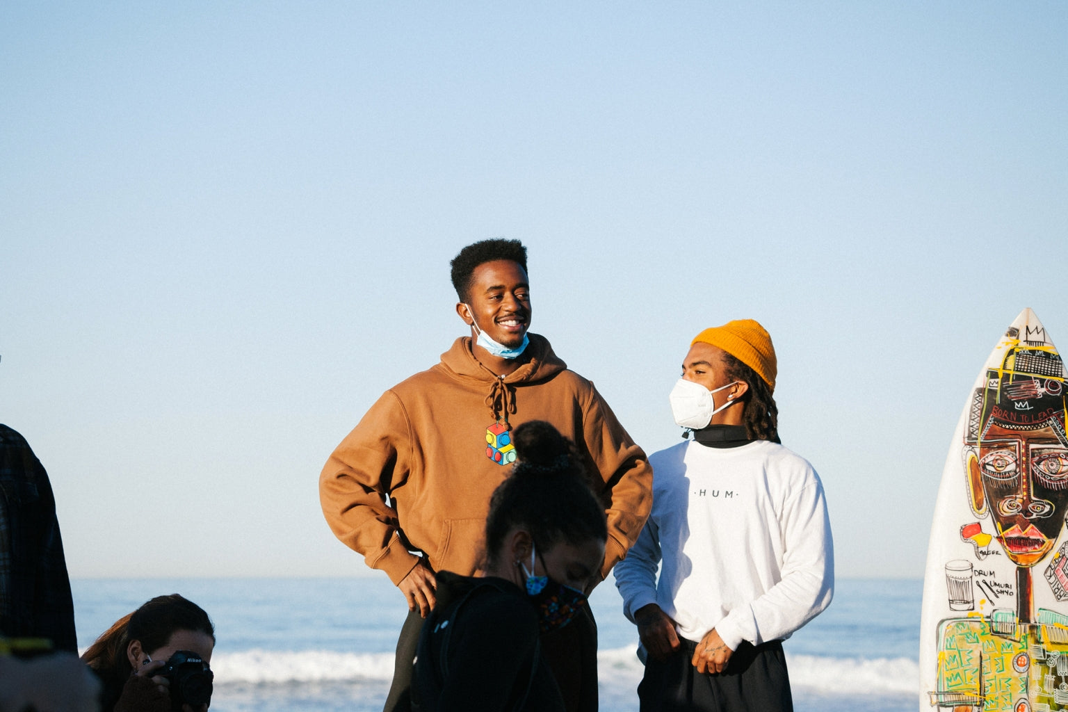 Brick and Gage Crismond admire the turnout of Black surfers and their allies during Black Sand's Peace Paddle on February 21, 2021.