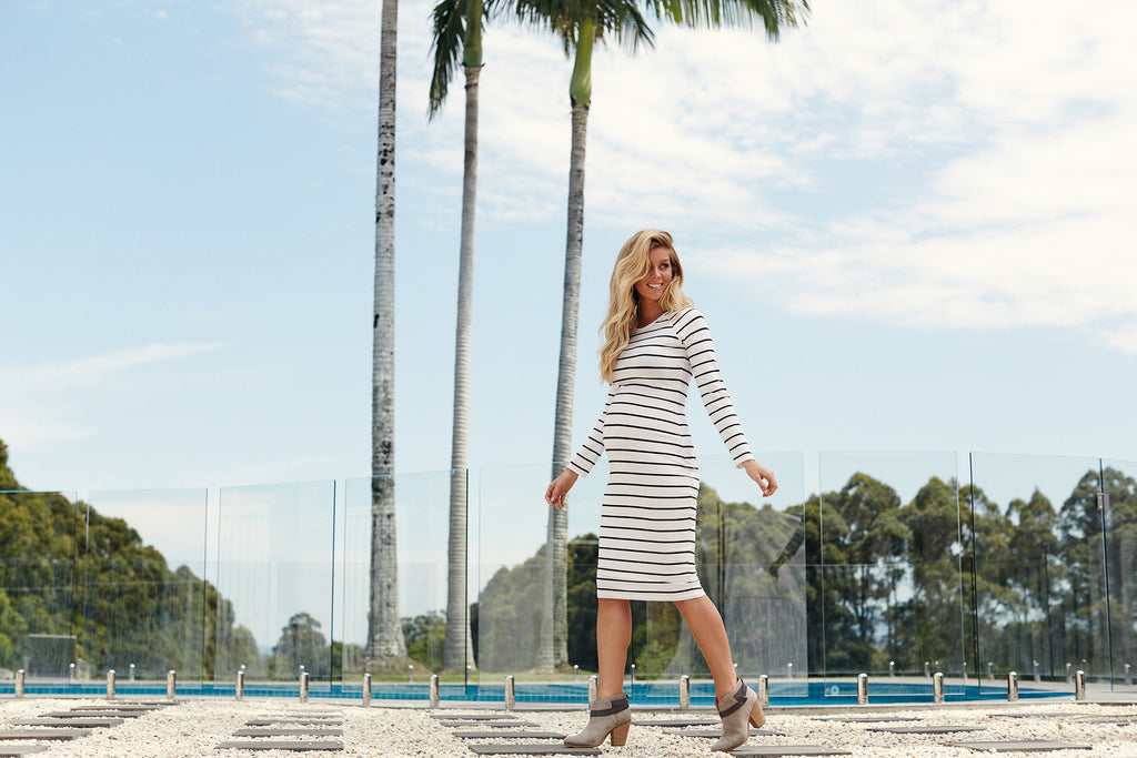 Maternity dress white with blue stripe outdoors