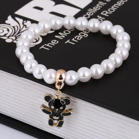 White Bracelet With Golden Bear Charm