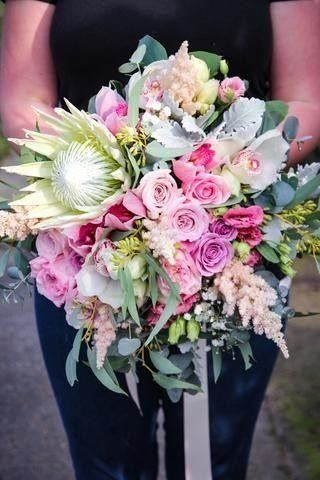 Bride Bouquet, wedding bouquet, featuring a king protea, cymbidium orchids, roses, astilbe in pinks, whites and mauve