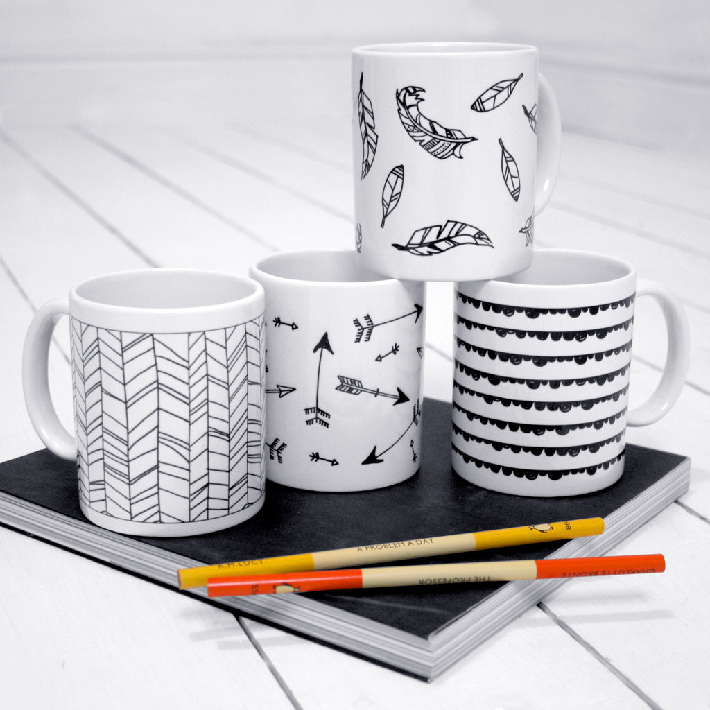 Set Of Four Mono Mugs