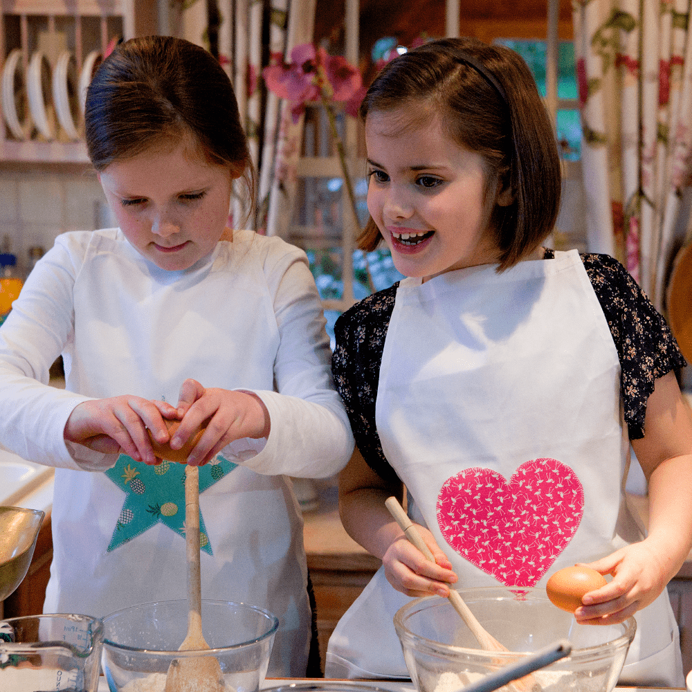 Aprons with Star in Pineapple Punch and Heart in Flirty Flamingo