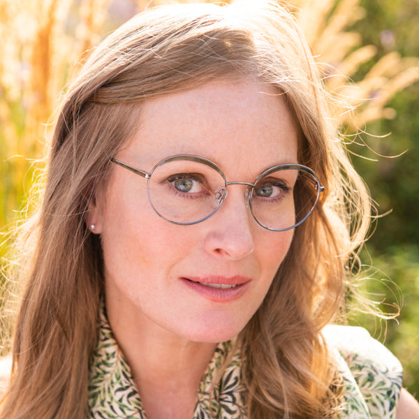 Sarah wears Willow Bough frames in green from the William Morris Gallery Collection