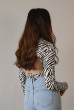 OPEN BACK ZEBRA MOCK NECK
