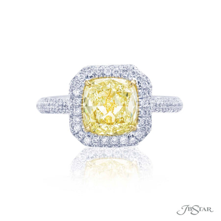 Stunning diamond ring featuring a 2.21ct. GIA certified fancy yellow cushion cut diamond edged with micro pave and fancy yellow micro pave. Handcrafted in platinum and 18KY gold. [details] Center Stone(s) SHAPE TYPE WEIGHT COLOR CLARITY Cushion Diamond 2.21 ct. Fancy Yellow VS2 Notes: GIA Stone Information SHAPE TYPE WEIGHT Round Round Diamond Fancy Yellow Diamond 0.77 ctw. 0.12 ctw. [enddetails] | JB Star 0138-069 Diamond Centers & Engagement
