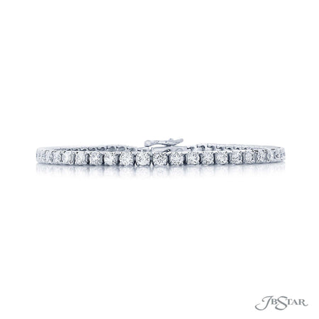 Dazzling diamond bracelet featuring 53 perfectly matched round diamonds. Handcrafted in a pure platinum prong setting. [details] Stone Information SHAPE TYPE WEIGHT Round Diamond 4.48 ctw. [enddetails] | JB Star 0212-001 Bracelets