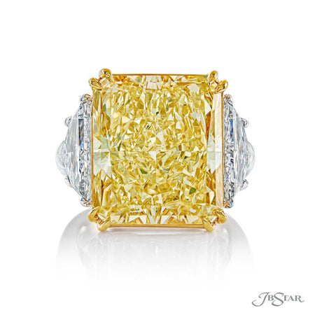 Magnificent fancy yellow diamond ring featuring a spectacular 17.23 ct. GIA Certified radiant cut fancy yellow diamond center, embraced by 2 trapezoid diamonds. Handcrafted in a platinum and 18KY gold setting. [details] Center Stone(s) SHAPE TYPE WEIGHT COLOR CLARITY Radiant Cut Diamond 17.23 ct. Fancy Yellow SI1 Notes: GIA Stone Information SHAPE TYPE WEIGHT Trapezoid Diamond 2.54 ct. [enddetails] | JB Star 0283-001 Diamond Centers & Engagement