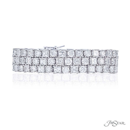 Magnificent diamond bracelet featuring 3 rows of square emerald-cut and round diamonds in a shared prong setting. Handcrafted in pure platinum. [details] Stone Information SHAPE TYPE WEIGHT Square Emerald Diamond 27.68 ctw. Round Diamond 18.32 ctw. [enddetails] | JB Star 0395-001 Bracelets