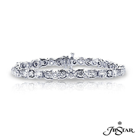 Elegant diamond bracelet featuring 44 brilliant round diamonds prong set in an intricate design. Handcrafted in platinum. [details] Stone Information SHAPE TYPE WEIGHT Round Diamond 10.23 ctw. [enddetails] | JB Star 0533-001 Bracelets