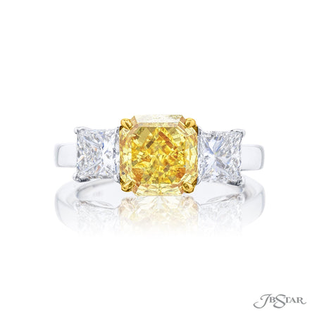 Gorgeous fancy yellow diamond ring featuring a 1.78 ct. GIA certified fancy intense yellow radiant-cut diamond center embraced between two princess-cut diamonds. Handcrafted in pure platinum. [details] Center Stone(s) SHAPE TYPE WEIGHT CLARITY Radiant Fancy Intense Yellow 1.78 ct. VS2 Notes: GIA Stone Information SHAPE TYPE WEIGHT Princess Diamond 1.48 ctw. [enddetails] | JB Star 0574-041 Diamond Centers & Engagement