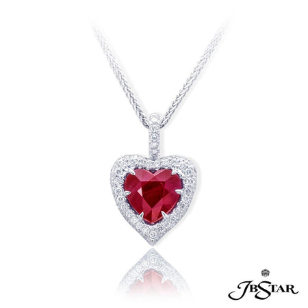 Dazzling ruby and diamond pendant featuring a 3.44 ct heart shape Burma ruby center edged in round diamond pave. [details] Center Stone(s) SHAPE TYPE WEIGHT Heart Ruby 3.44 ct. Stone Information SHAPE TYPE WEIGHT Round Diamond 0.60 ctw. [enddetails] | JB Star 0632-013 Pendants