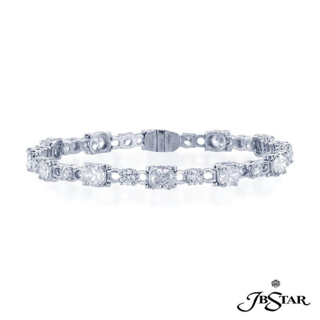 Dazzling diamond bracelet showcasing oval and round diamonds in an alternating design. Handcrafted in platinum. [details] Stone Information SHAPE TYPE WEIGHT Oval Round Diamond Diamond 5.44 ctw. 1.87 ctw. [enddetails] | JB Star 0689-001 Bracelets