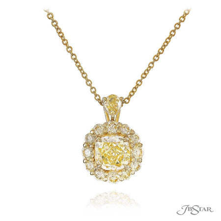Gorgeous fancy yellow diamond pendant featuring a 1.36 ct. GIA certified cushion cut fancy yellow diamond center encircled by fancy yellow round diamonds, handcrafted in 18KY. [details] Center Stone(s) SHAPE TYPE WEIGHT COLOR CLARITY Cushion Diamond 1.36 ct. Fancy Yellow VS1 Stone Information SHAPE TYPE WEIGHT COLOR Round Diamond 0.73 ct. Fancy Yellow [enddetails] | JB Star 0702-010 Pendants
