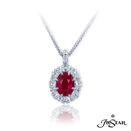 Stunning ruby and diamond pendant featuring an amazing 2.21 ct oval Burma ruby encircled by oval diamonds. [details] Center Stone(s) SHAPE TYPE WEIGHT Oval Ruby 2.21 ct. Stone Information SHAPE TYPE WEIGHT Oval Diamond 1.26 ctw [enddetails] | JB Star 0779-042 Pendants