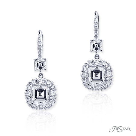 Dazzling diamond drop earrings featuring 2.99 ctw square emerald cut centers embraced with round diamonds and hung by additional square emerald diamonds. Handcrafted in pure platinum. [details] Center Stone(s) SHAPE TYPE WEIGHT COLOR CLARITY Square Emerald Square Emerald Diamond Diamond 1.55 ct. 1.54 ct. G G VS2 VS2 Notes: GIA Stone Information SHAPE TYPE WEIGHT Round Square Emerald Diamond Diamond 1.56 ctw. 0.72 ctw. [enddetails] | JB Star 0783-021 Earrings
