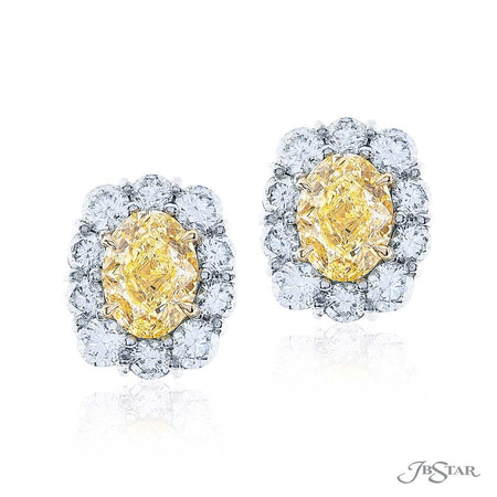 Dazzling fancy yellow diamond stud earrings featuring fancy light yellow oval diamond centers encircled by round diamonds. Handcrafted in pure platinum. [details] Center Stone(s) SHAPE TYPE WEIGHT COLOR CLARITY Radiant Radiant Diamond Diamond 1.52 ct. 1.50 ct. Fancy Light Yellow Fancy Light Yellow VS2 VVS2 Stone Information SHAPE TYPE WEIGHT Round Diamond 1.95 ctw. [enddetails] | JB Star 0783-040 Earrings
