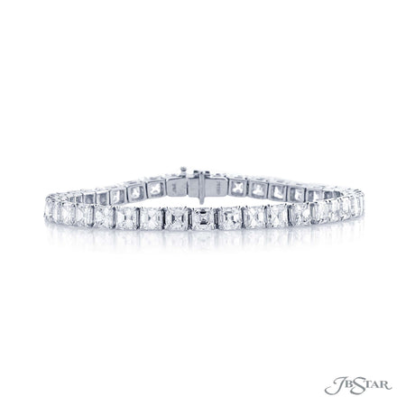 Spectacular diamond bracelet featuring 39 beautifully matched square emerald cut diamonds in a four prong setting. Handcrafted in pure platinum. [details] Stone Information SHAPE TYPE WEIGHT Square Emerald Diamond 16.04 ctw. [enddetails] | JB Star 0845-002 Bracelets