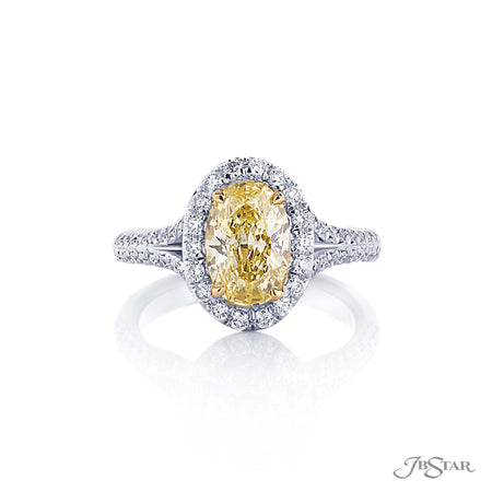 Gorgeous fancy yellow diamond engagement ring featuring a 1.59 ct. GIA certified fancy yellow oval diamond center in a beautiful micro pave split shank setting. Handcrafted in pure platinum. [details] Center Stone(s) SHAPE TYPE WEIGHT COLOR CLARITY Oval Diamond 1.59 ct. Yellow SI1 Notes: GIA Stone Information SHAPE TYPE WEIGHT Round Diamond 0.58 ctw. Round Yellow Diamond 0.08 ctw. [enddetails] | JB Star 0974-312 Diamond Centers & Engagement
