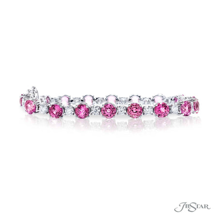 Gorgeous pink sapphire and diamond bracelet featuring round sapphires and round diamonds in a shared prong setting. Handcrafted in pure platinum. [details] Stone Information SHAPE TYPE WEIGHT Round Pink Sapphire 19.16 ctw. Round Diamond 3.43 ctw. [enddetails] | JB Star 1067-007 Bracelets