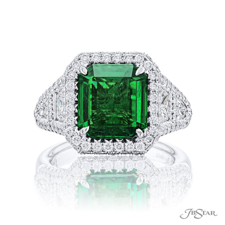 Stunning emerald & diamond ring featuring a 3.60 ct. emerald embraced by trapezoid and shield diamonds in a micro pave setting. Handcrafted in pure platinum. [details] Center Stone(s) SHAPE TYPE WEIGHT Emerald Emerald 3.60 ct. Stone Information SHAPE TYPE WEIGHT Trapezoid Round Shield Diamond Diamond Diamond 1.10 ct. 0.99 ct. 0.39 ct. [enddetails] | JB Star 1112-006 Precious Color Rings