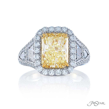 Stunning diamond ring featuring a 3.36 ct. GIA certified fancy light yellow radiant-cut diamond embraced by trapezoid and shield diamonds in a micro pave setting. Handcrafted in platinum and 18KY gold. [details] Center Stone(s) SHAPE TYPE WEIGHT COLOR CLARITY Radiant Diamond 3.36 ct. Fancy Light Yellow VVS2 Notes: GIA Stone Information SHAPE TYPE WEIGHT Trapezoid Round Shield Diamond Diamond Diamond 1.18 ctw. 0.64 ctw. 0.38 ctw. [enddetails] | JB Star 1112-008 Diamond Centers & Engagement
