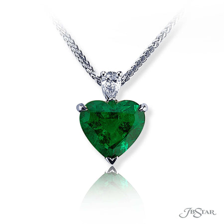 Stunning Emerald and diamond pendant featuring a 4.11 ct. certified heart shaped Emerald hung by a brilliant round diamond. Handcrafted in pure platinum. [details] Center Stone(s) SHAPE TYPE WEIGHT Heart Emerald 4.11 ct. Stone Information SHAPE TYPE WEIGHT Round Diamond 0.20 ctw. [enddetails] | JB Star 1199-070 Pendants