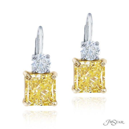 Dazzling fancy yellow diamond drop earrings featuring 2 certified radiant-cut fancy yellow diamonds hung by round diamonds. Handcrafted in pure platinum. [details] Center Stone(s) SHAPE TYPE WEIGHT COLOR CLARITY Radiant Radiant Diamond Diamond 1.51 ct. 1.51 ct. Fancy Yellow Fancy Yellow SI1 SI1 Stone Information SHAPE TYPE WEIGHT Round Diamond 0.52 ctw. [enddetails] | JB Star 1199-073 Earrings