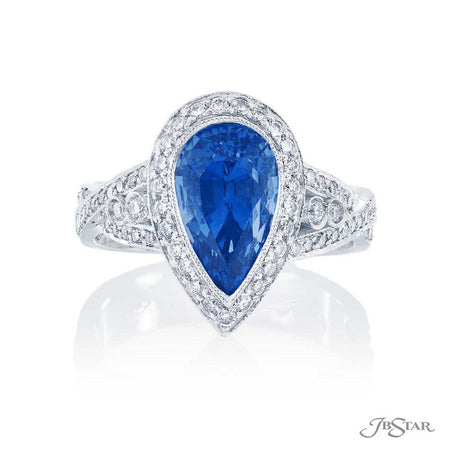 Beautiful sapphire and diamond ring featuring a 3.86 ct. pear-shape blue sapphire in a stunning vintage design with round diamonds. Handcrafted in pure platinum. [details] Center Stone(s) SHAPE TYPE WEIGHT Pear Sapphire 3.86 ct. Stone Information SHAPE TYPE WEIGHT Round Diamond 0.93 ctw. [enddetails] | JB Star 1334-003 Precious Color Rings