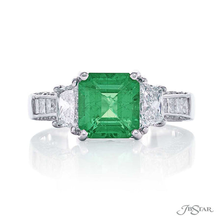 Stunning emerald and diamond ring featuring a 1.84ct. emerald-cut emerald embraced by princess-cut, trapezoid and round diamonds. Handcrafted in pure platinum. [details] Center Stone(s) SHAPE TYPE WEIGHT Emerald Emerald 1.84 ct. Stone Information SHAPE TYPE WEIGHT Trapezoid Diamond 0.87 ctw. Round Diamond 0.26 ctw. Princess Diamond 0.28 ctw. [enddetails] | JB Star 1341-013 Precious Color Rings