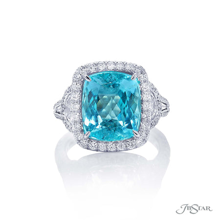 Dazzling paraiba and diamond ring featuring a 6.83 ct. certified cushion cut paraiba center embraced by half-moon and tapered baguette diamonds in a micro pave setting. Handcrafted in pure platinum. [details] Center Stone(s) SHAPE TYPE WEIGHT Cushion Paraiba 6.83 ct. Notes: Gubelin Stone Information SHAPE TYPE WEIGHT Half Moon Diamond 1.00 ctw. Tapered Baguette Diamond 0.20 ctw. Round Diamond 0.94 ctw. [enddetails] | JB Star 1366-054 Precious Color Rings