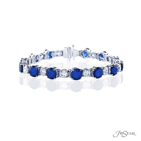 Magnificent bracelet featuring round blue sapphires and round diamonds in an alternating design handcrafted in pure platinum. [details] Stone Information SHAPE TYPE WEIGHT Round Sapphire 21.45 ctw. Round Diamond 5.21 ctw. [enddetails] | JB Star 1385-001 Bracelets