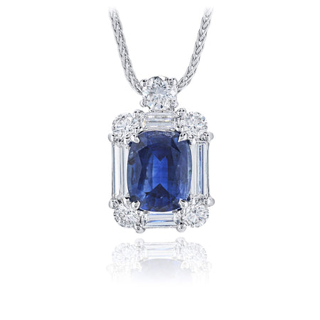Stunning sapphire and diamond pendant featuring a 2.28 ct. cushion-cut sapphire center encircled by baguette and round diamonds, hung by a round diamond. Handcrafted in pure platinum. [details] Center Stone(s) SHAPE TYPE WEIGHT Cushion Sapphire 2.28 ct. Stone Information SHAPE TYPE WEIGHT Round Baguette Diamond Diamond 0.59 ctw. 0.52 ctw. [enddetails] | JB Star 1621-020 Pendants