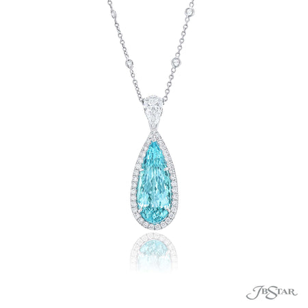 Magnificent paraiba and diamond pendant featuring a gorgeous 7.33 ct. certified pear shaped paraiba, encircled by round diamond pave and hung by a pear diamond. Handcrafted in pure platinum. [details] Center Stone(s) SHAPE TYPE WEIGHT Pear Paraiba 7.33 ct. Stone Information SHAPE TYPE WEIGHT Round Pear Diamond Diamond 0.42 ctw. 0.80 ctw. [enddetails] | JB Star 1631-135 Pendants