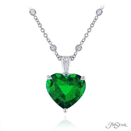 Dazzling emerald and diamond pendant featuring a 7.13 ct. certified heart-shaped green emerald hung by a tapered baguette diamond. Handcrafted in pure platinum. [details] Center Stone(s) SHAPE TYPE WEIGHT Heart Emerald 7.13 ct. Notes: CDC Stone Information SHAPE TYPE WEIGHT Tapered Baguette Diamond 0.32 ct. [enddetails] | JB Star 1637-059 Pendants