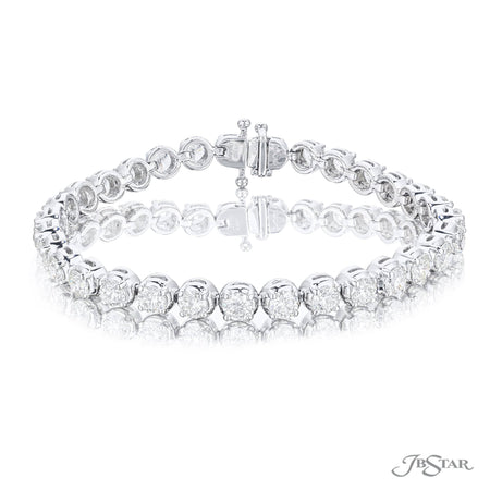 Dazzling diamond bracelet featuring 31 round diamonds in a shared prong bezel-setting. Handcrafted in pure platinum. [details] Stone Information SHAPE TYPE WEIGHT Round Diamond 9.41 ctw. [enddetails] | JB Star 1726-002 Bracelets