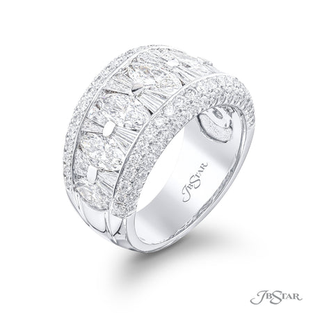 Dazzling diamond wedding band featuring marquise and tapered baguettes in a beautiful center channel designed surrounded by round diamonds pave. Handcrafted in pure platinum. [details] Stone Information SHAPE TYPE WEIGHT Marquise Tapered Baguette Round Diamond Diamond Diamond 2.10 ctw. 0.80 ctw. 0.93 ctw. [enddetails] | JB Star 1937-016 Anniversary & Wedding