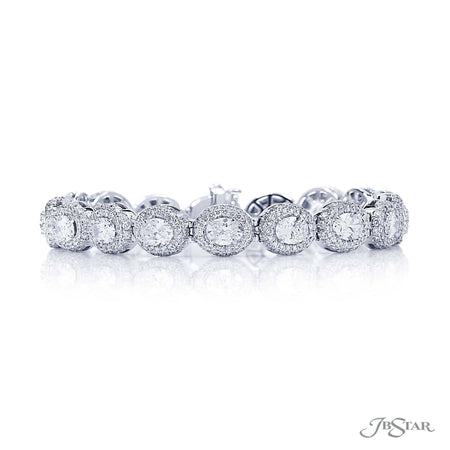 Dazzling diamond bracelet featuring 19 perfectly matched oval diamonds in surrounded by round diamond pave. Handcrafted in pure platinum. [details] Stone Information SHAPE TYPE WEIGHT Oval Diamond 6.71 ctw. Round Diamond 4.47 ctw. [enddetails] | JB Star 1989-001 Bracelets