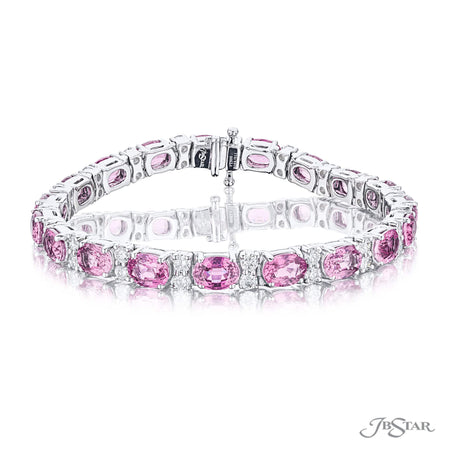 Beautiful pink sapphire and diamond bracelet featuring oval pink sapphires and round diamonds in a shared prong setting. Handcrafted in pure platinum. [details] Stone Information SHAPE TYPE WEIGHT Oval Pink Sapphires 20.08 ctw. Round Diamond 2.80 ctw. [enddetails] | JB Star 2095-011 Bracelets