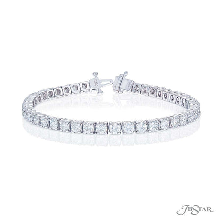 Dazzling diamond bracelet featuring 45 round diamonds in a beautiful 4 prong setting. Handcrafted in pure platinum. [details] Stone Information SHAPE TYPE WEIGHT Round Diamond 6.81 ctw. [enddetails] | JB Star 2383-002 Bracelets