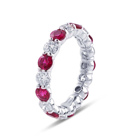 Beautiful ruby and diamond eternity band featuring 9 round rubies and 9 round diamonds in an alternating shared prong design. Handcrafted in platinum. [details] Center Stone(s) SHAPE TYPE WEIGHT Round Ruby 2.00 ctw. Stone Information SHAPE TYPE WEIGHT Round Diamond 1.34 ctw. [enddetails] | JB Star 2424-026 Anniversary & Wedding