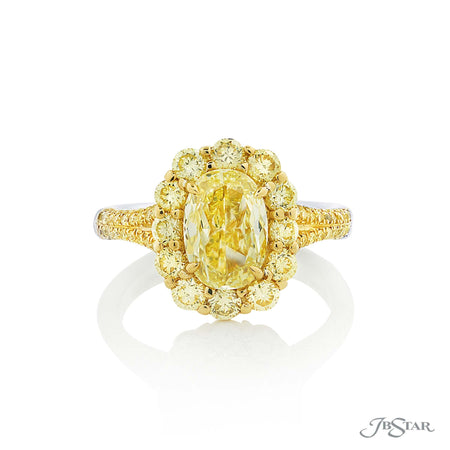 Stunning fancy yellow diamond ring featuring a 1.50 ct. GIA certified oval fancy yellow diamond center encircled with round diamonds and micro pave on the shank. Handcrafted in 18KY gold and pure platinum. [details] Center Stone(s) SHAPE TYPE WEIGHT COLOR CLARITY Oval Diamond 1.50 ct. Fancy Yellow SI2 Notes: GIA Stone Information SHAPE TYPE WEIGHT Round Diamond 1.13 ctw. [enddetails] | JB Star 2468-028 Diamond Centers & Engagement